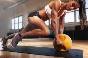 bigstock-Muscular-Woman-Doing-Intense-C-98972252