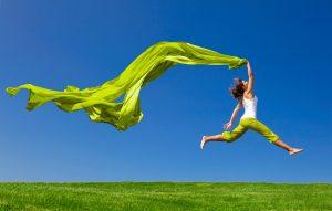 bigstock-Beautiful-young-woman-jumping--15095405