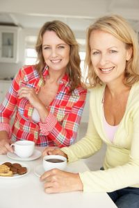 bigstock-Mid-age-women-chatting-over-co-23244707