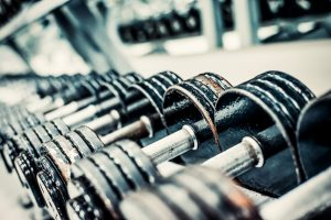 bigstock-Sports-dumbbells-in-modern-spo-82840448